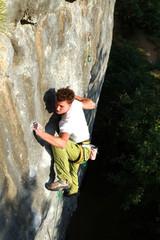A man climbs a wall.