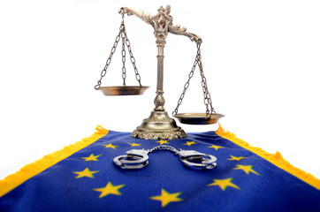 Scales of Justice , handcuffs and European Union flag