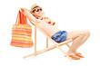 Man enjoying sun on a beach chair, isolated on white
