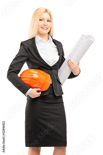Female architect in black suit holding a helmet and a blueprint