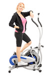Mature woman athlete on a cross trainer fitness machine