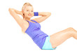 Young female in sportswear doing ab exercises