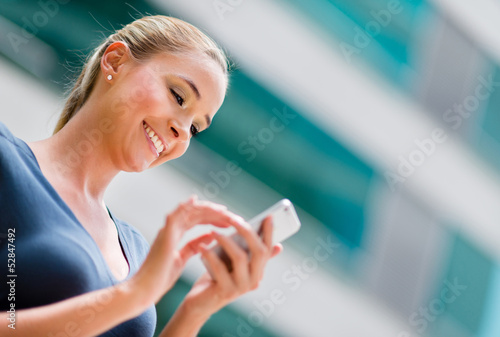 canvas print picture Business woman using a smart phone