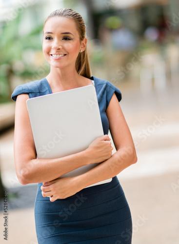 Business woman walking outdoors