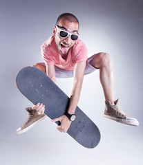 crazy guy with a skateboard making funny faces