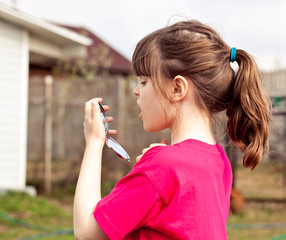 Upset  6 aged girl checking her  milky teeth.