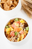 Granola (muesli flakes) and ears of wheat