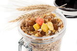 Granola (muesli flakes) with dried fruit in a glass jar
