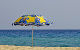 umbrella on the beach  sky in background