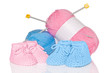 Baby booties with wool and knitting needles