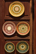 Pottery dishes in oriental style at wooden stand