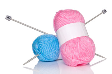 Balls of wool and knitting needles.