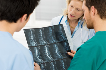 Doctors Examining X-ray Report