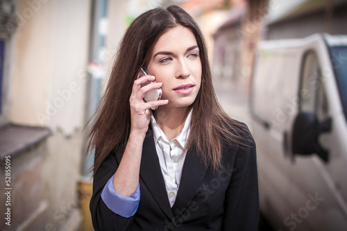 Businesswoman calling outdoor