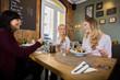 Women Having Food In Restaurant