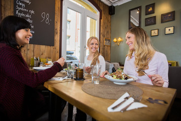 Women Having Food In Restaurant