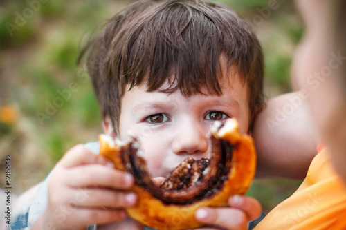 Little boy showing cocoa snail