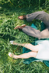 Laying couple in the high grass