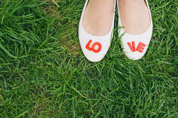 White woman shoes with red LOVE letters