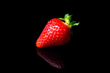 Strawberry on the black background
