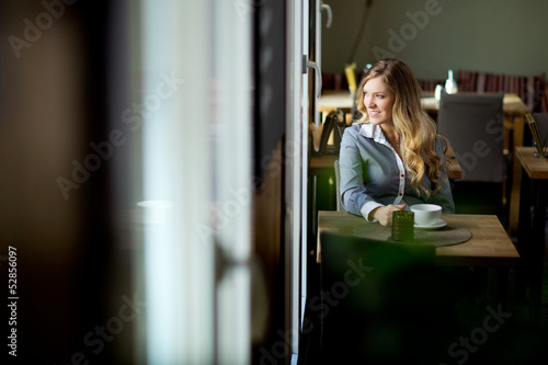 Attractive Woman Alone in Cafe