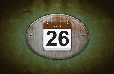 Old wooden calendar with June 26.