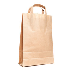 Modern shopping paper bag isolated on white