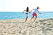Children couple running on beach.