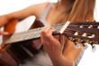 Closeup image of guitar in woman hands