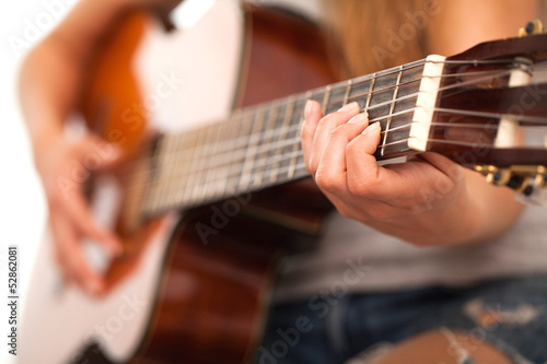 Closeup image of guitar in woman hands
