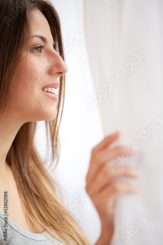 Beautiful caucasian woman looking at window