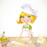 Ñute blond girl baking cookies isolated on white background