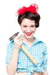 Funny pinup woman holding hammer