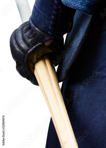 Close up of hand in kote with shinai, isolated on white