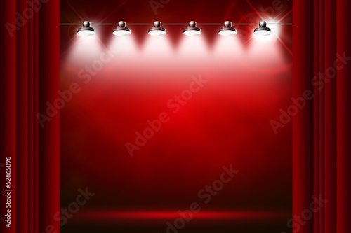 red background illuminated by spotlights and sparkles