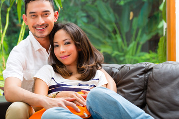 Asian couple on the sofa