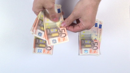 sharing euros banknotes on white