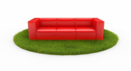Red sofa on green field