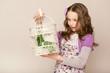 fashion little girl looks on birdcage