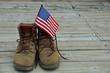 flag in worn work boots - 52868644