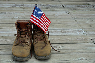 flag in worn work boots