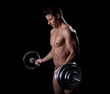 Portrait of strained athlete lifting rod
