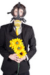 Man in gas mask with flowers