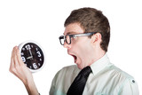 Scared businessman with clock