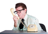Angry businessman yelling down phone