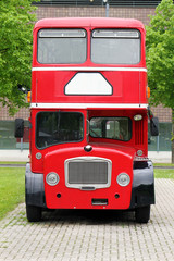 big red double decker bus on the street