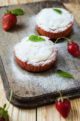 small muffins with strawberry jam
