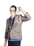 Helpless businessman holding rope with tied noose