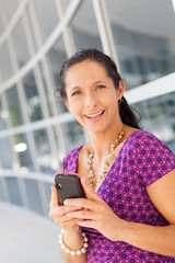 Hispanic woman holding cell phone