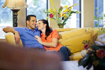 Man and woman sitting on couch.